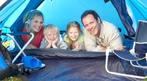 Family in tent on a campsite in Cornwall